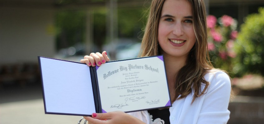 a person holding a diploma from Big Picture School