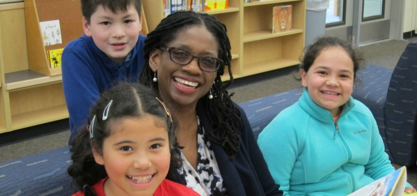 a photo of a Bellevue Schools Foundation employee smiling with students