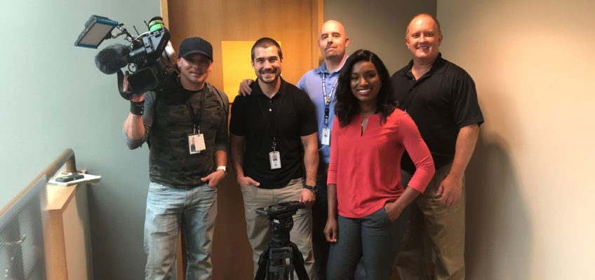 BSD's Safety & Security Team posing for a group photo with Q13's Nadia Romero and cameraman.