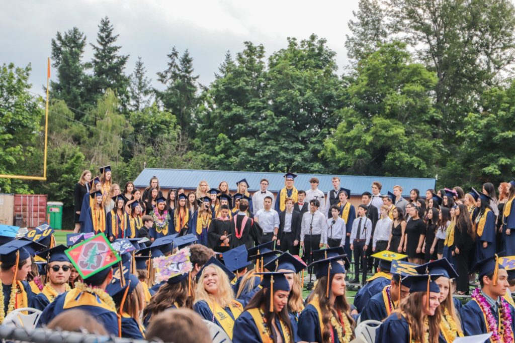 students singing in a graduation ceremony