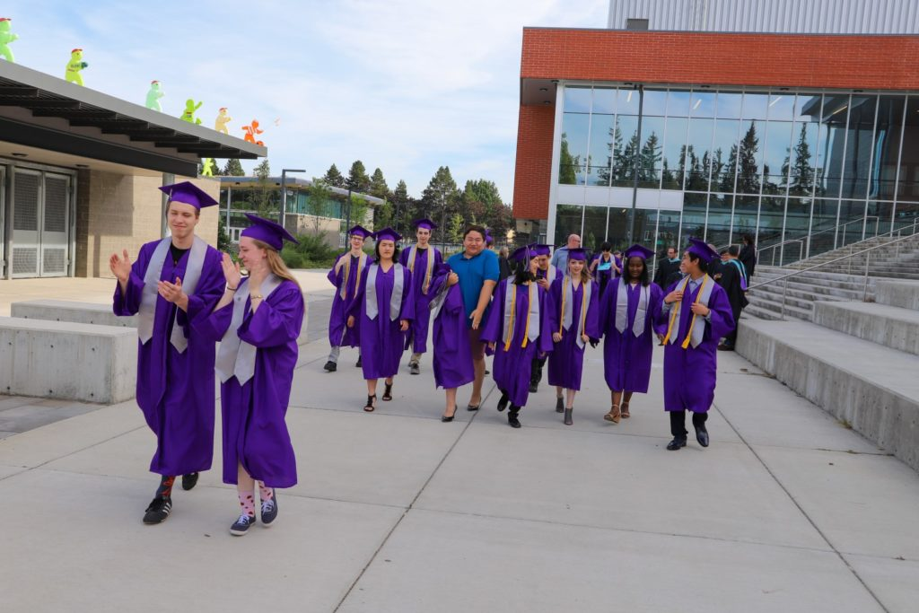 students walking at a graduation ceremony