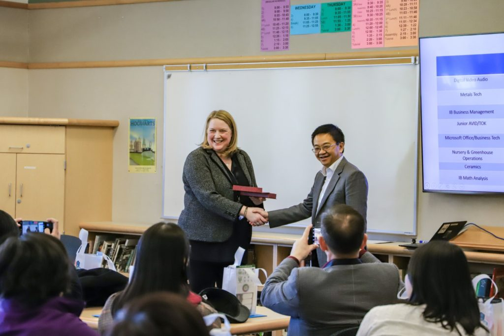 Interlake Principal shaking hands with Vice President of Tsinghua University