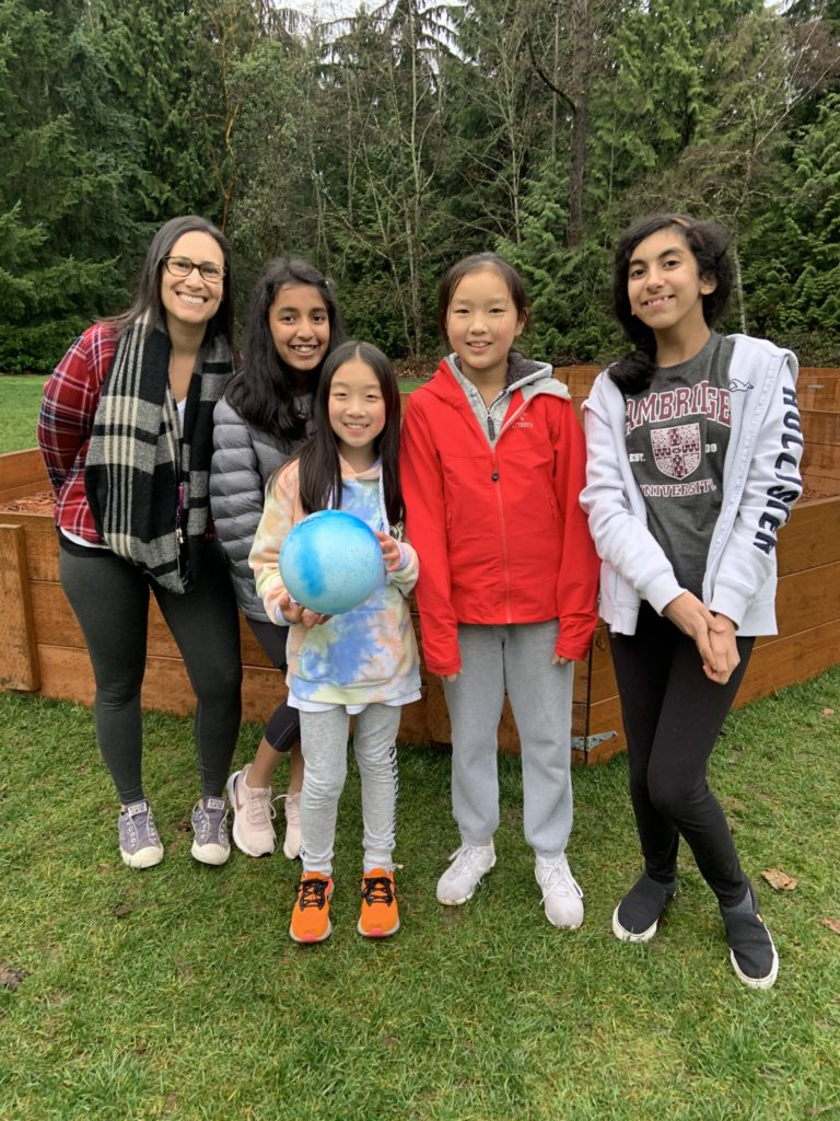 Cherry Crest students smiling in front of donated Gaga Ball pit