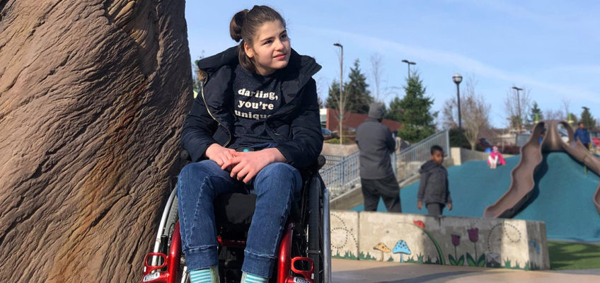 a student in a wheelchair at a playground