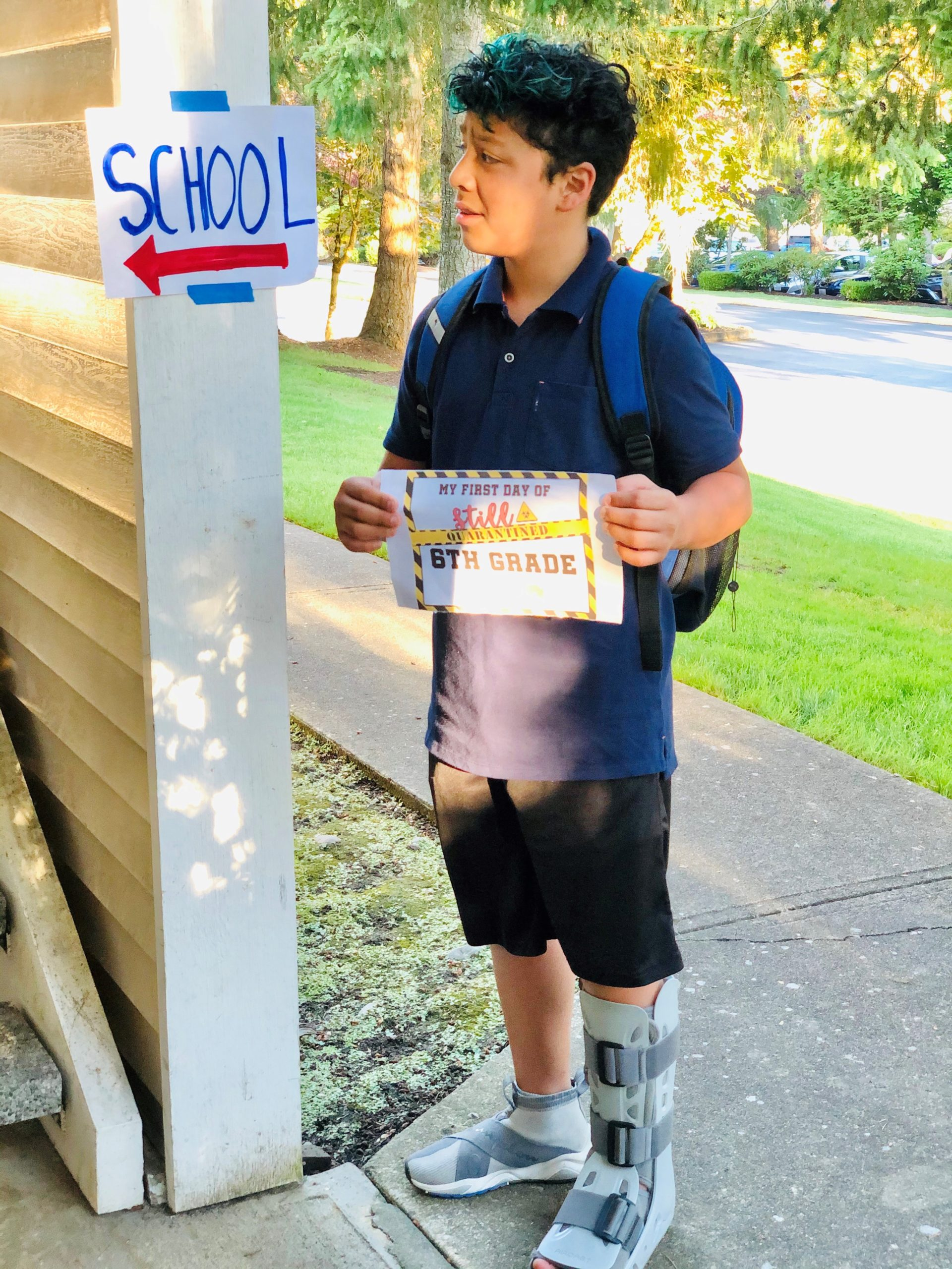 a student looking at a sign that say school
