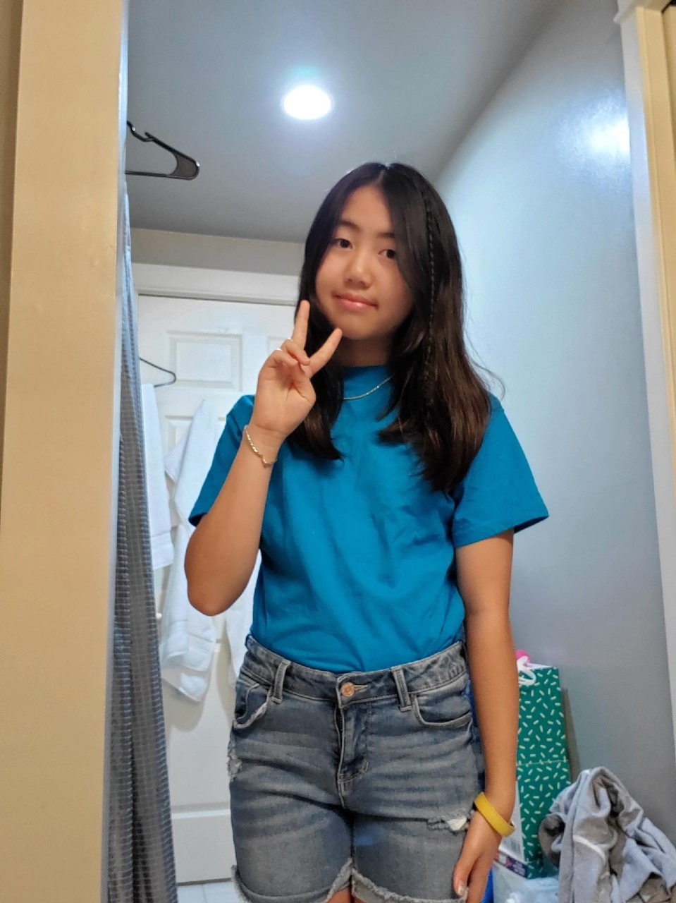 a student doing the peace sign