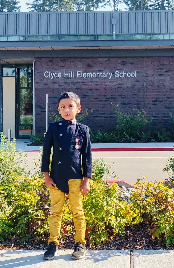 a student standing in front of Clyde Hill Elementary
