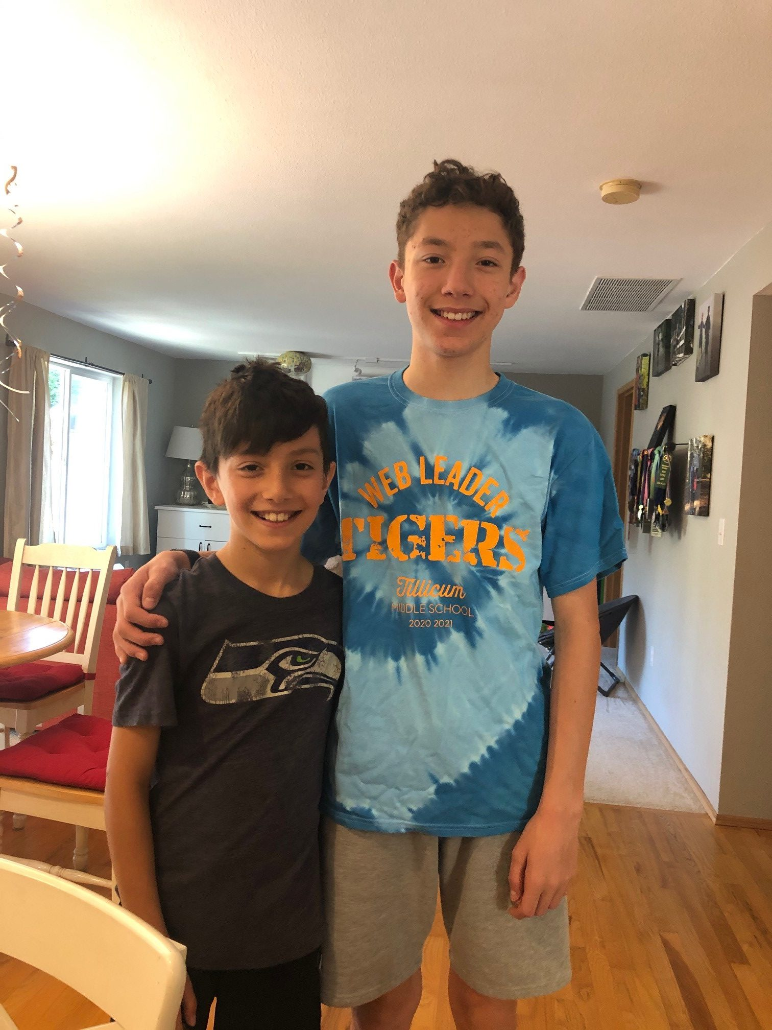 two brothers smiling for a photo
