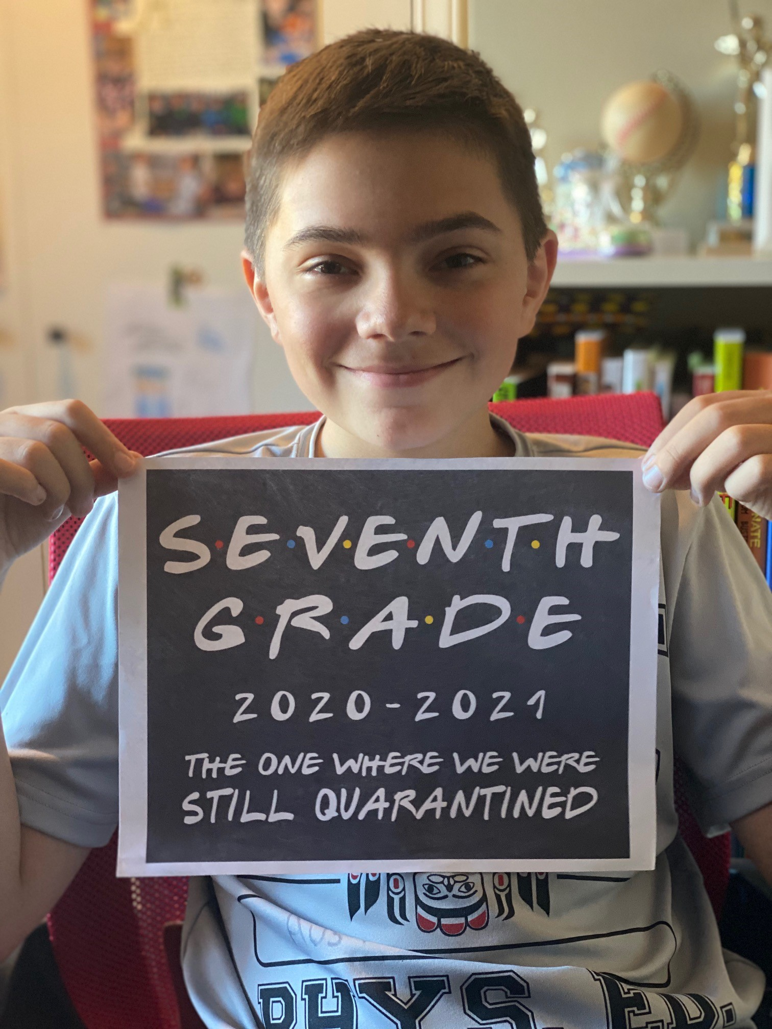 a student holding a BSD first day sign