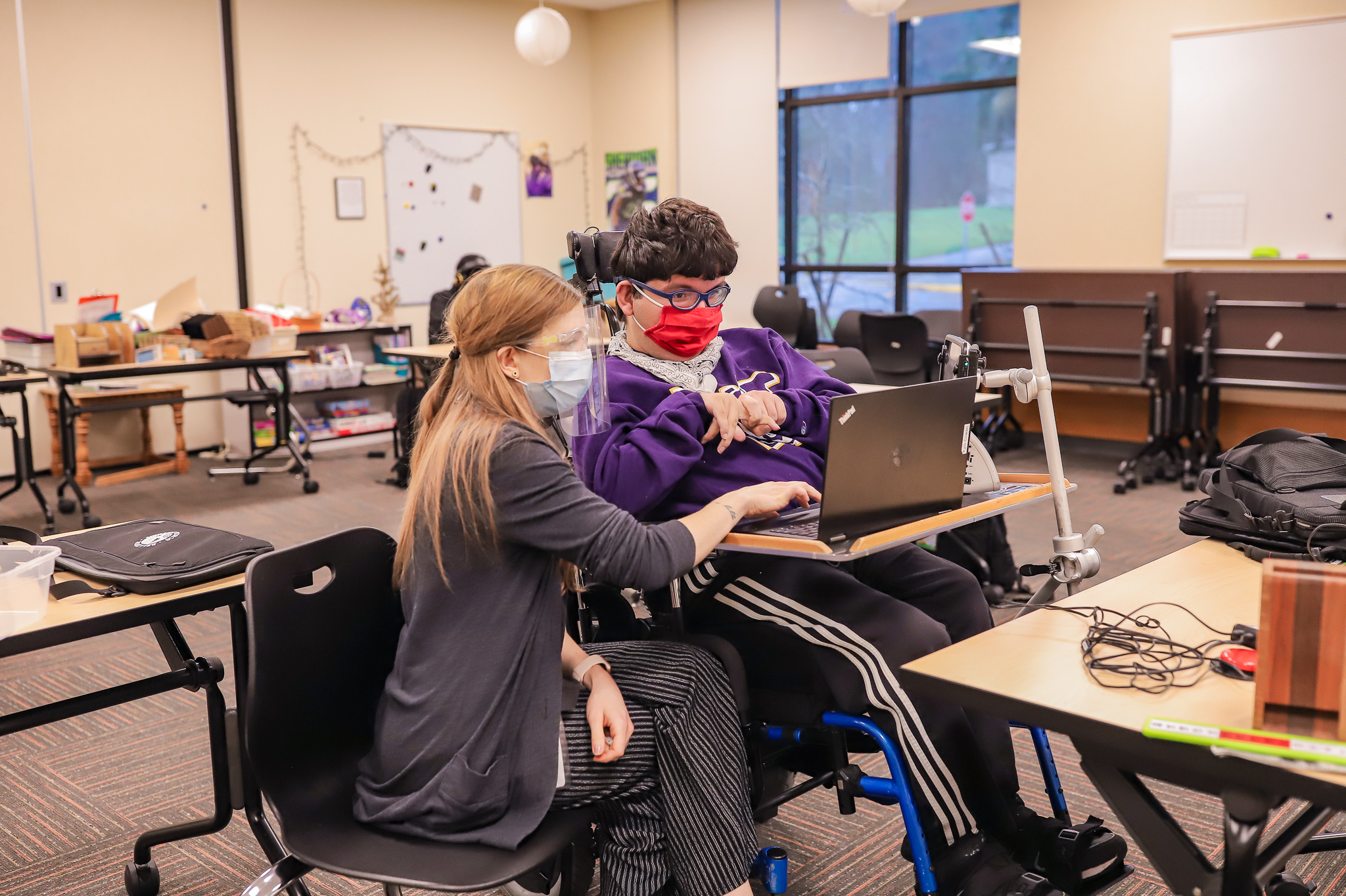 a Transition Academy student receives assistance typing from their instructor