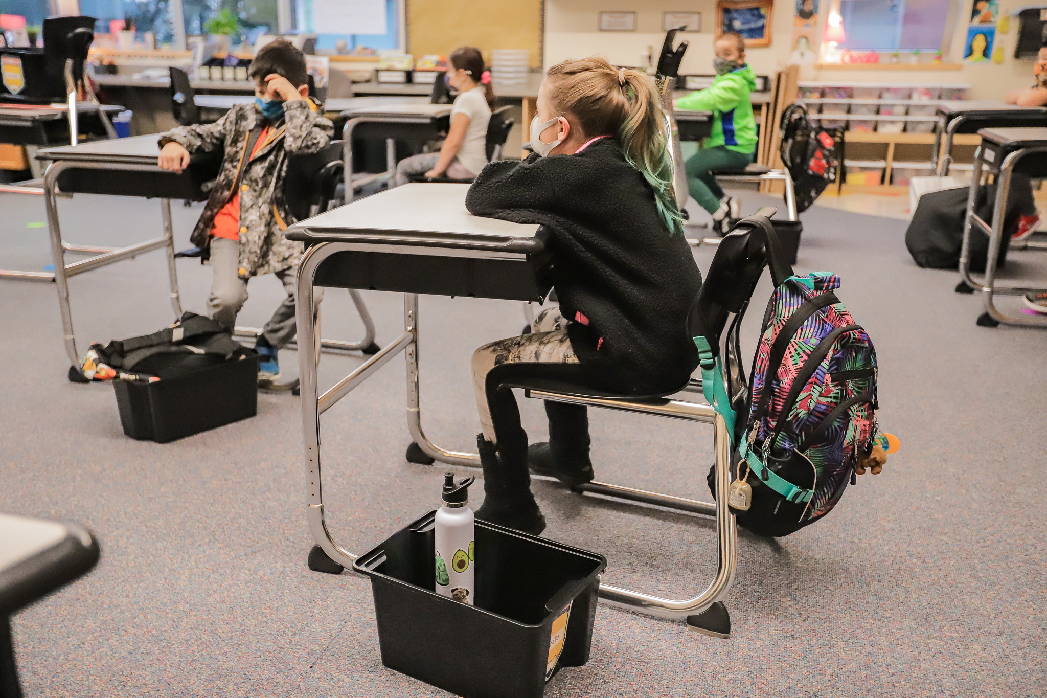Students sitting at school desks.
