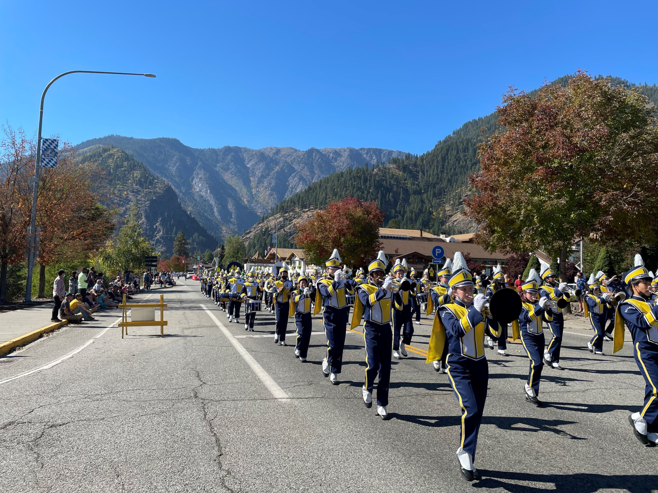 Bellevue High School Marching Band performing in parade in front of mountain