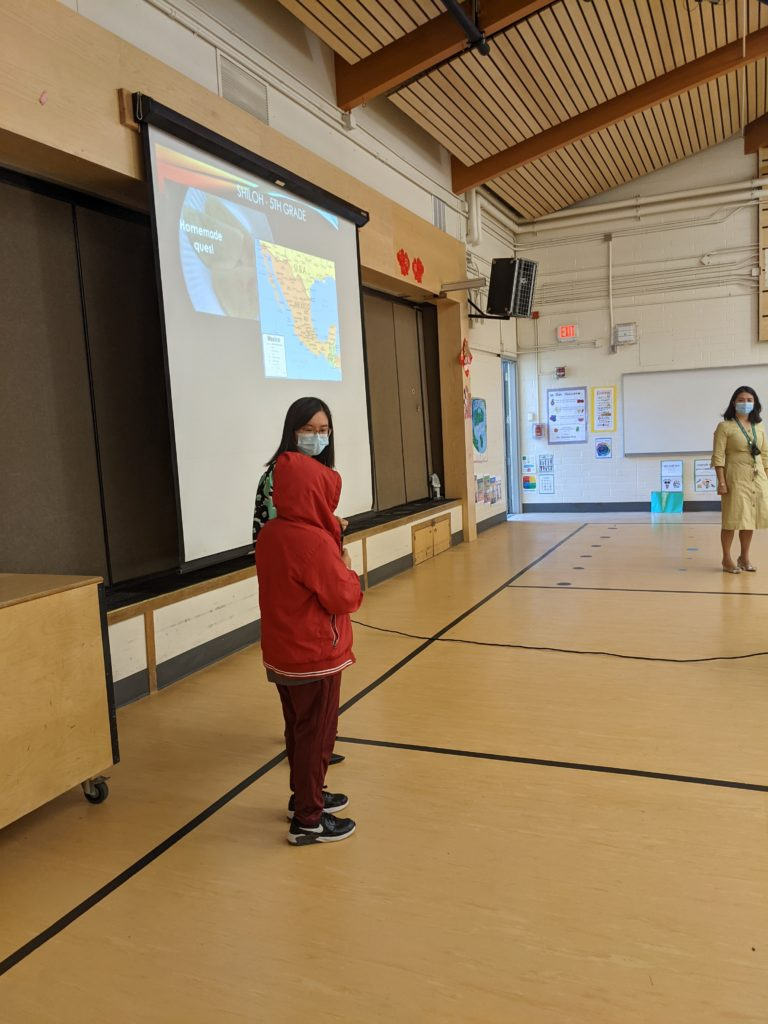 Student giving presentation at Jing Mei Elementary